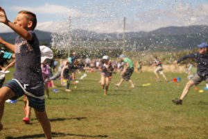 Year 5/6 students enjoying a water fight.